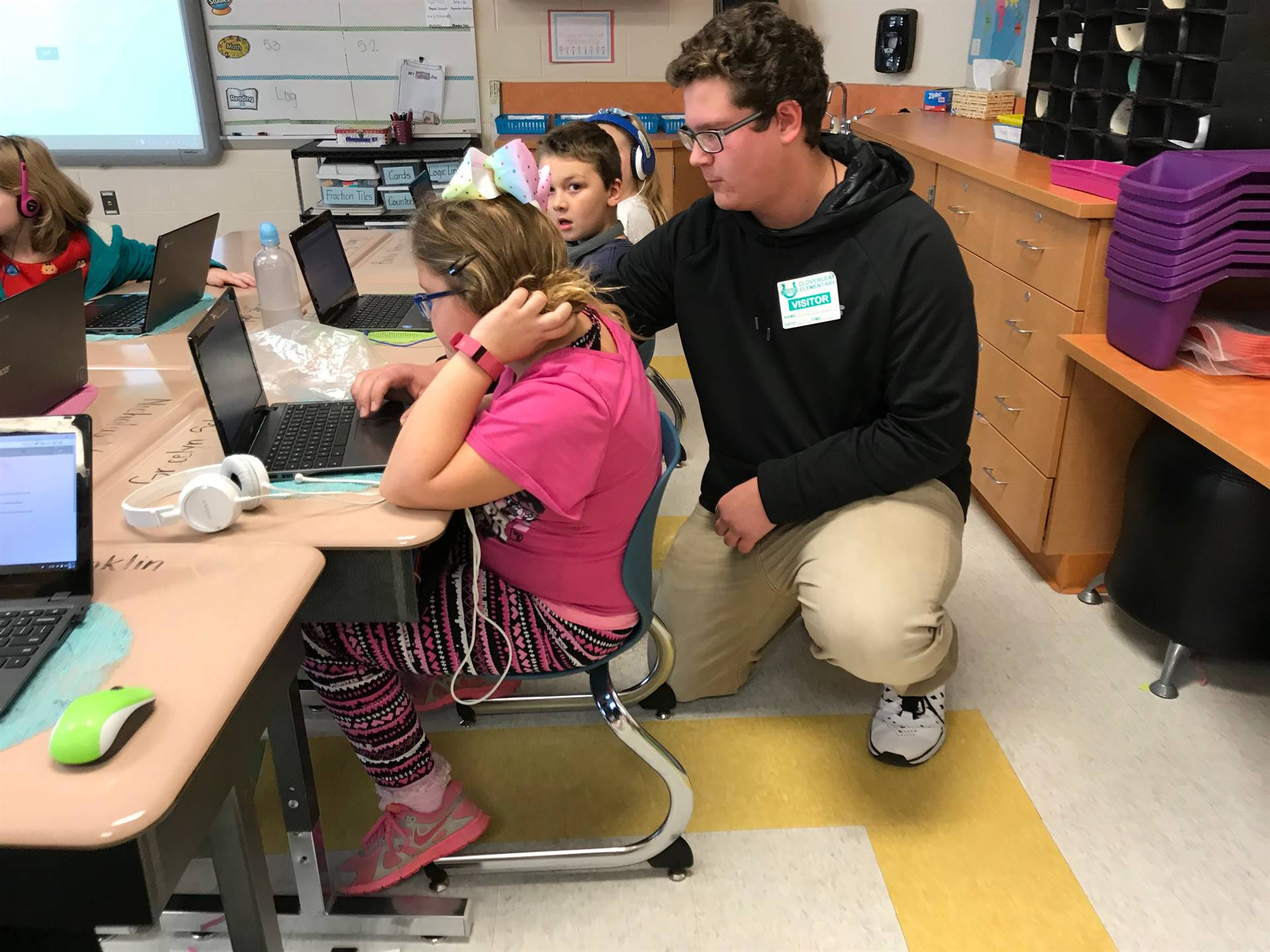 CHS sophomore Richard Laurence assists a third-grader