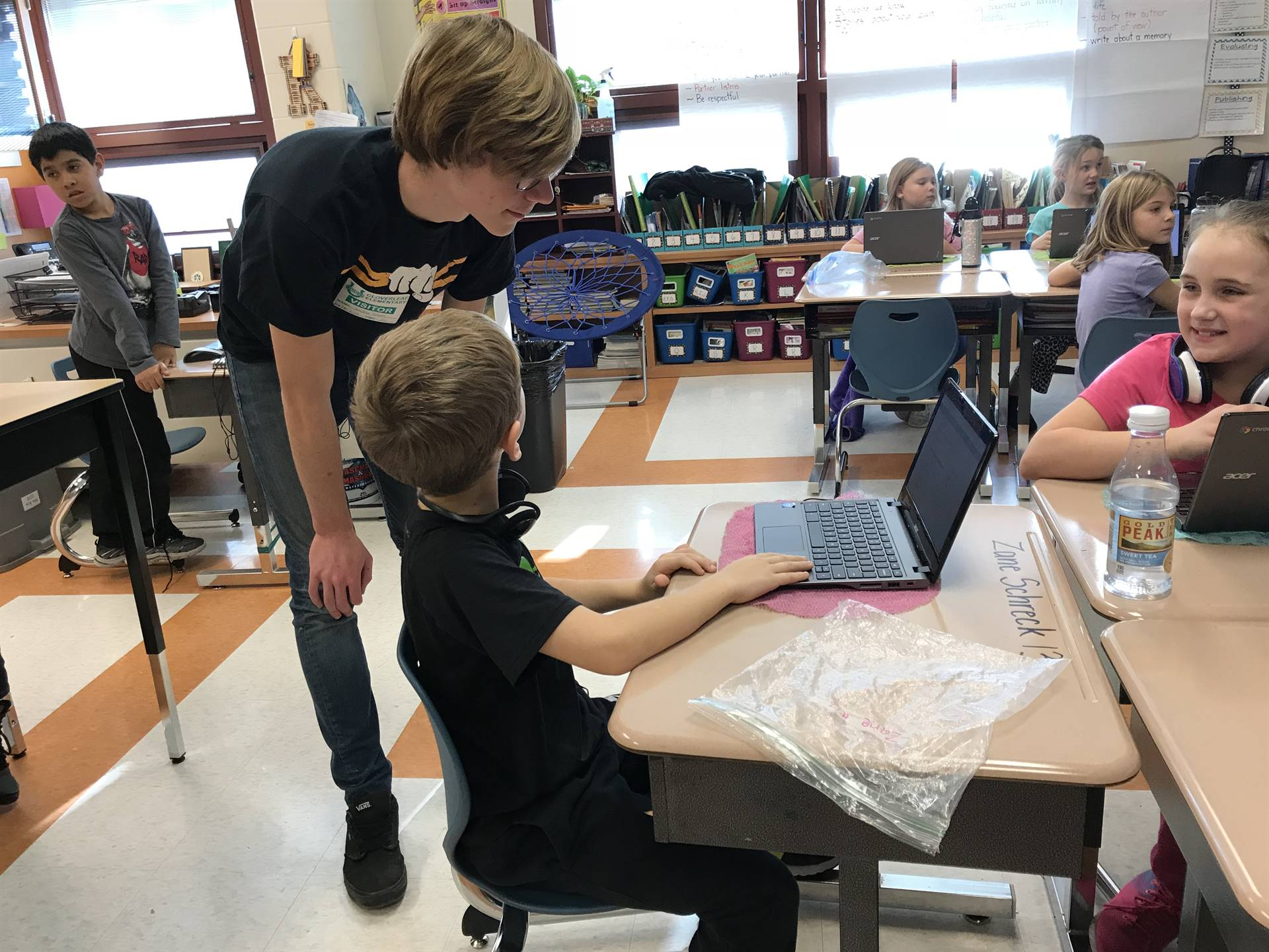 High-schoolers work one-on-one with third-graders.