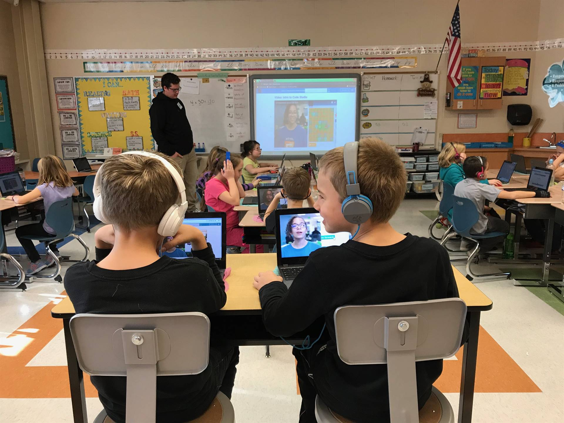 Sophomore Richard Laurence teaches third-graders about coding.