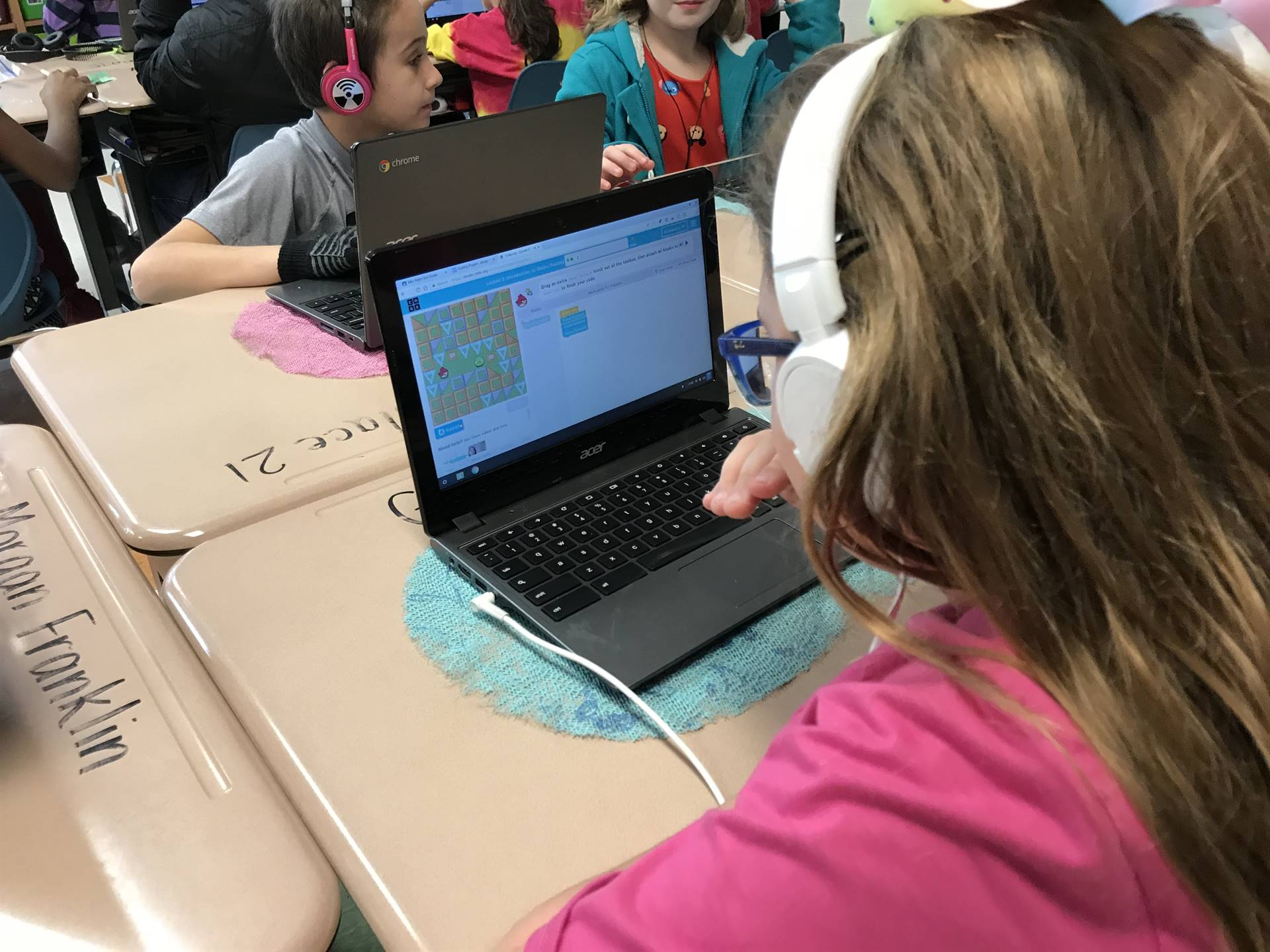 Students learning coding