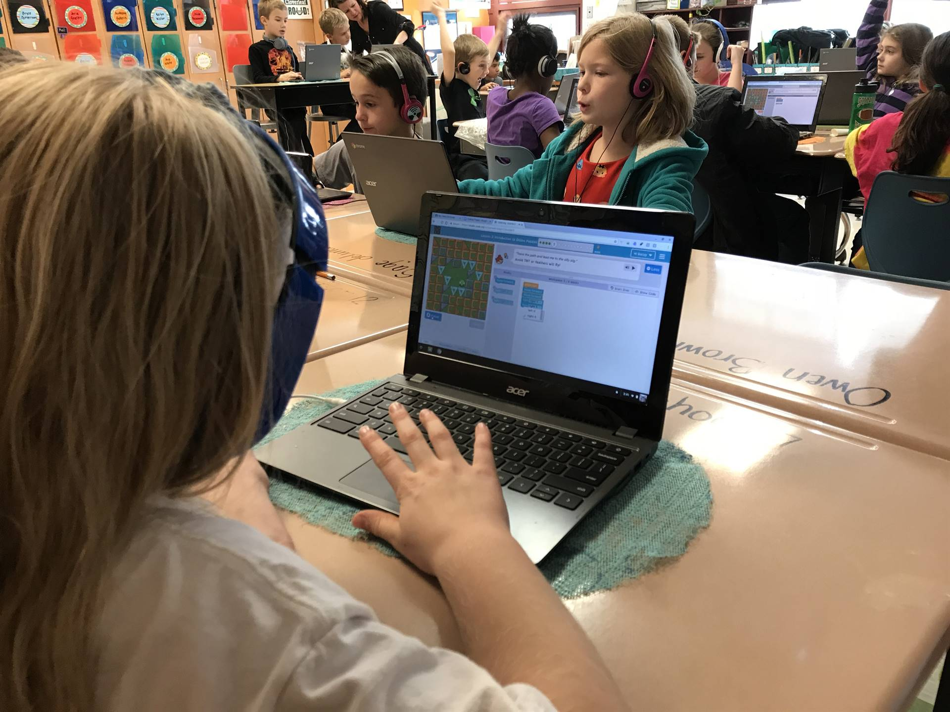 Students apply codes to help a character navigate a maze.