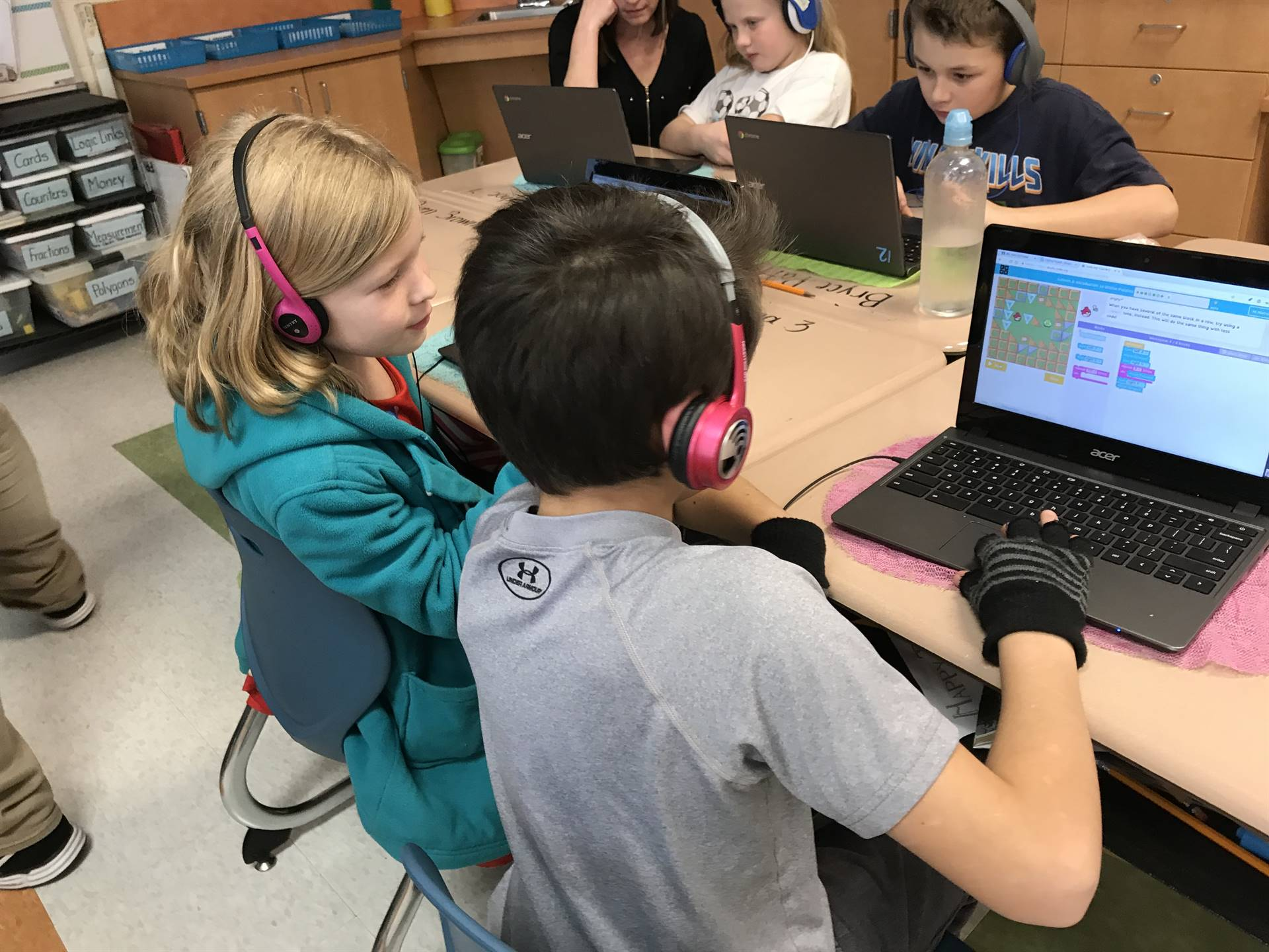Elementary students work on coding.