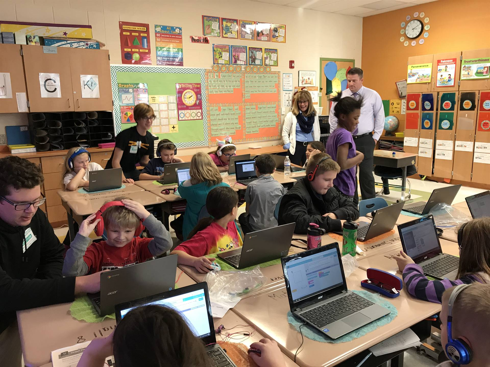 Students collaborate while learning to code.